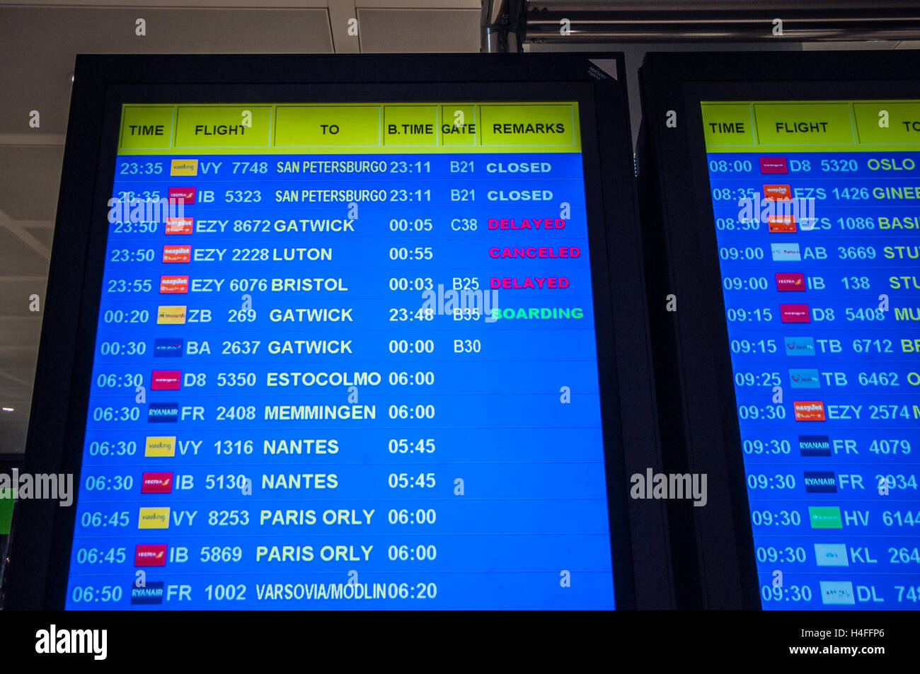 Departures board at Alicante Airport in Spain with a canceled and delayed flights. Airline and flight numbers. Boarding - Stock Image