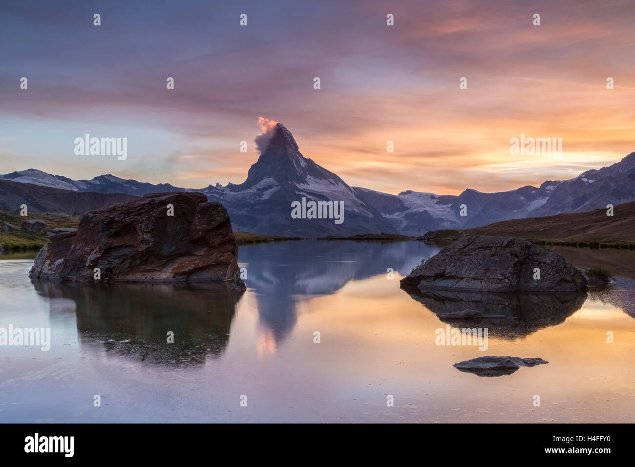 Matterhorn reflecting on the Stellisee Lake, Zermatt, Switzerland. - Stock Image