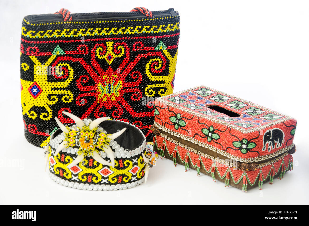 tissue box, woman bag, a crafting with dayak motif from kalimantan, Borneo, handmade crafting - Stock Image