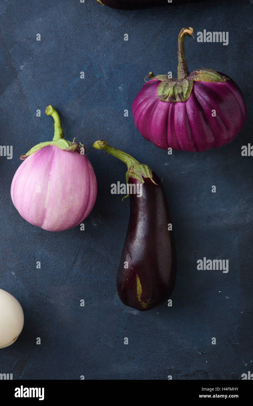 Organic eggplants on stone background, food above Stock Photo