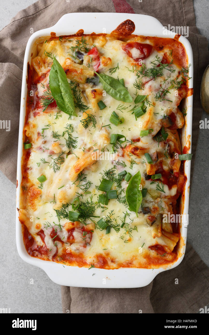 Pasta baked in baking dish, food top view - Stock Image
