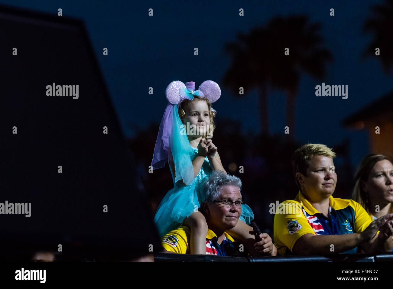 A young girl is entranced by Phillip Phillips' performance at the Closing Ceremony for the Invictus Games on - Stock Image
