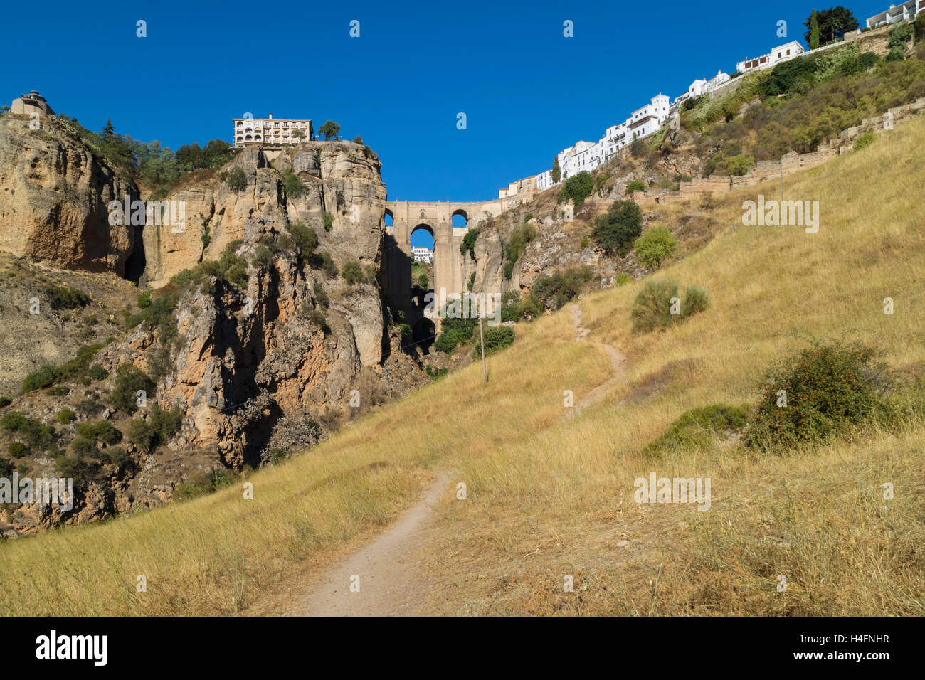 Ronda, Malaga Province, Andalusia, southern Spain.  The town on both sides of the El Tajo gorge, seen from below. - Stock Image