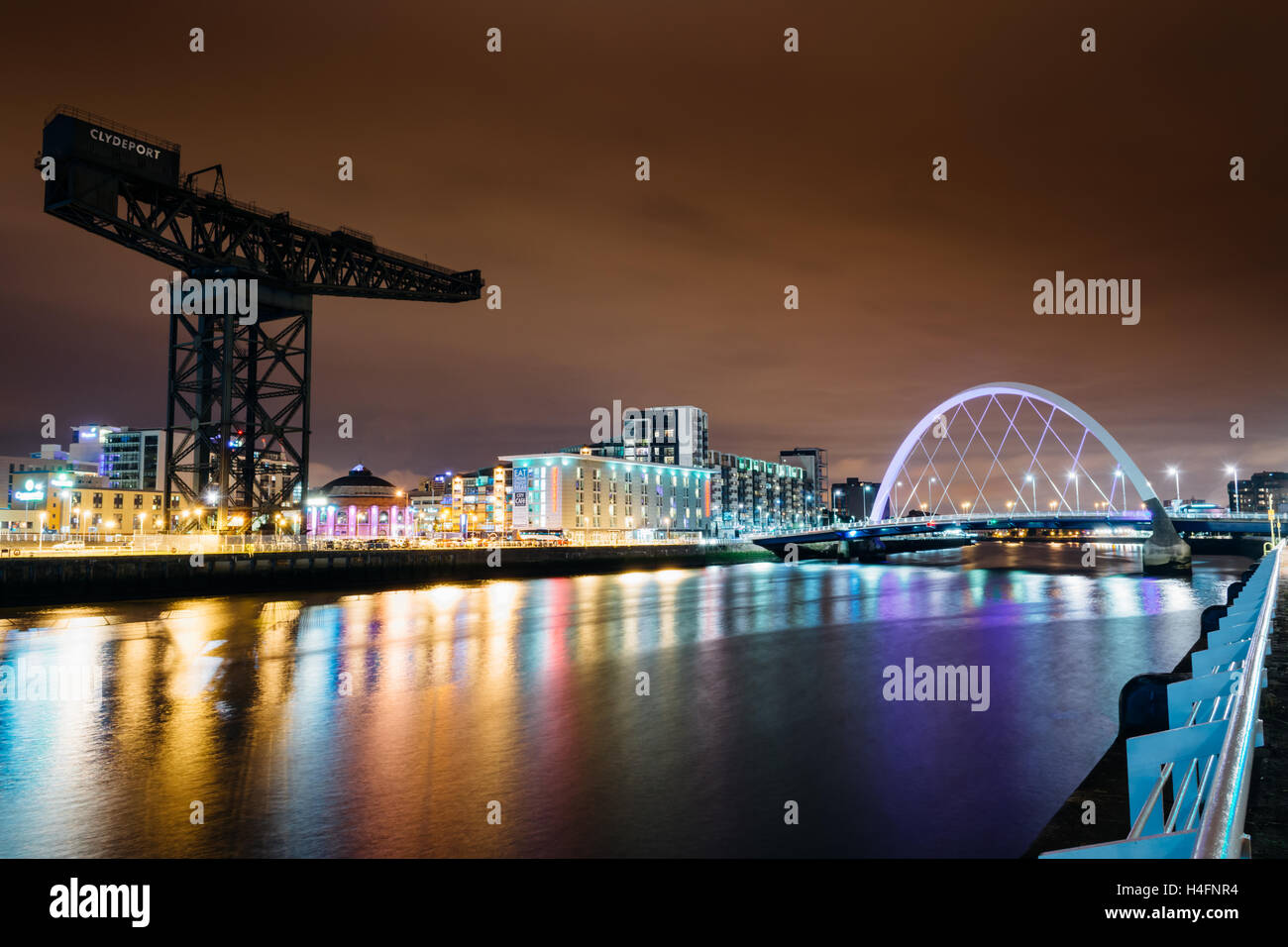 The Finnieston Crane and the Clyde Arc: a view from Pacific Quay on the banks of the river Clyde, Glasgow, Scotland - Stock Image