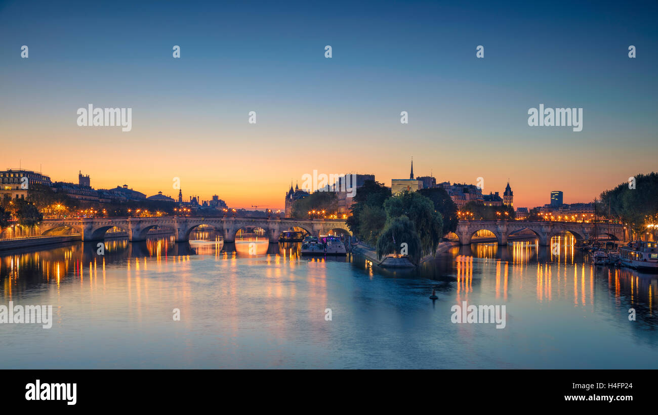 Paris Panorama. Panoramic image of Paris riverside during sunrise. - Stock Image