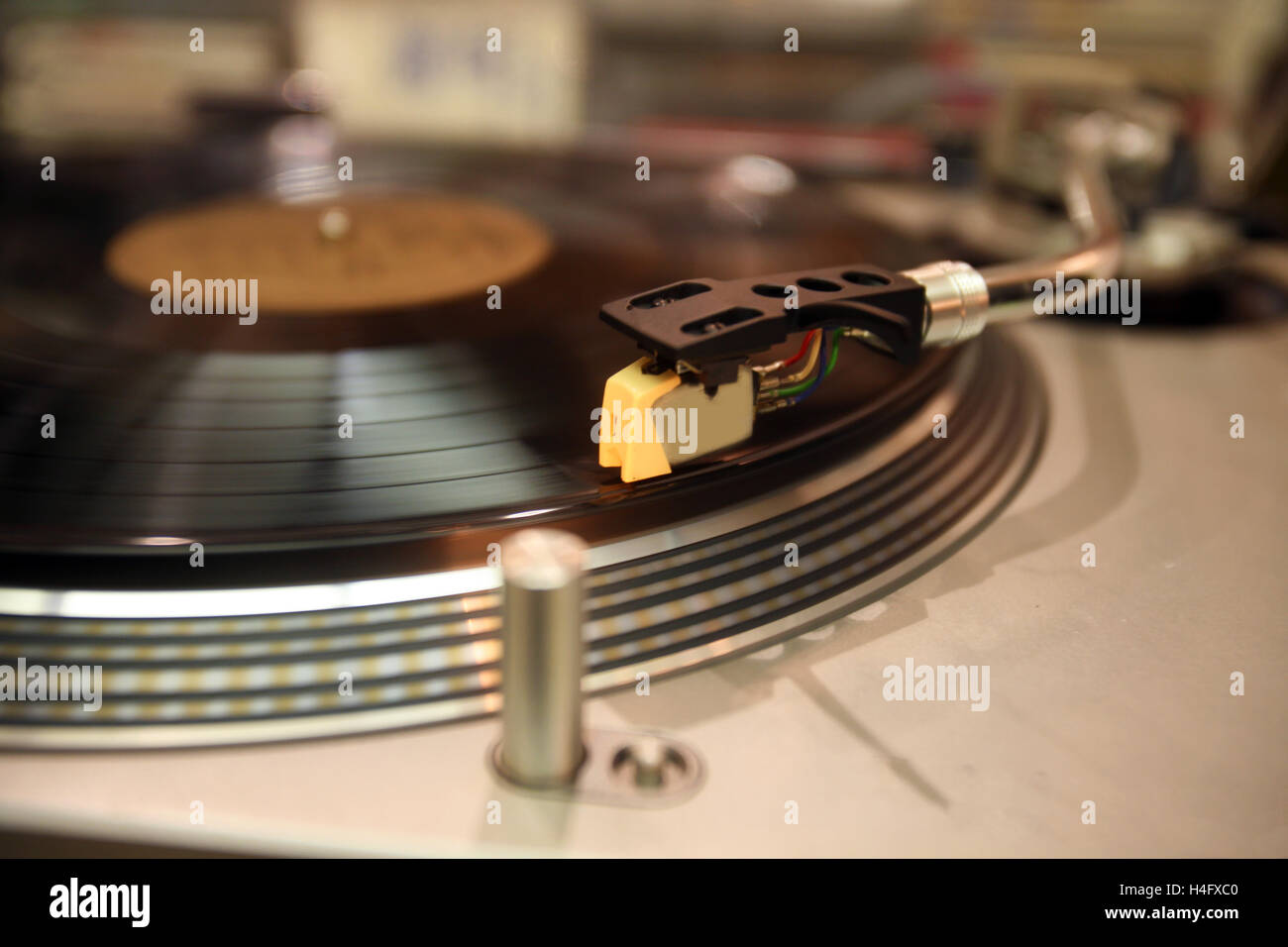 Turntable in action with focus on the cartridge - Stock Image