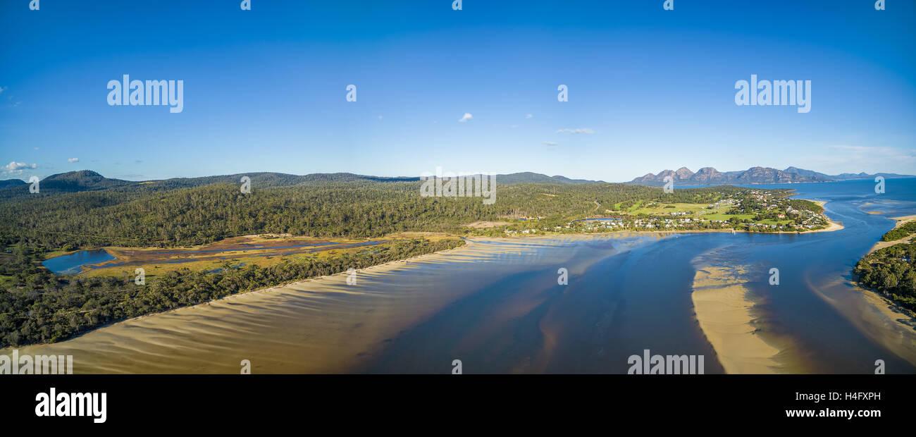 Aerial panorama of Coles Bay and The Hazards mountain range. Freycinet National Park, Tasmania, Australia - Stock Image
