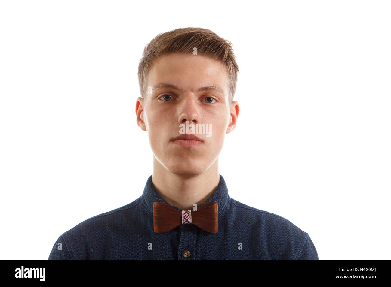 Man with a wooden bowtie - Stock Image