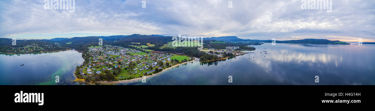 Aerial panorama of North West Bay and town of Snug near Hobart at sunset. Tasmania, Australia - Stock Image