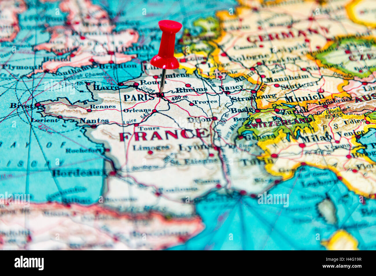 paris france pinned on vintage map of europe stock image