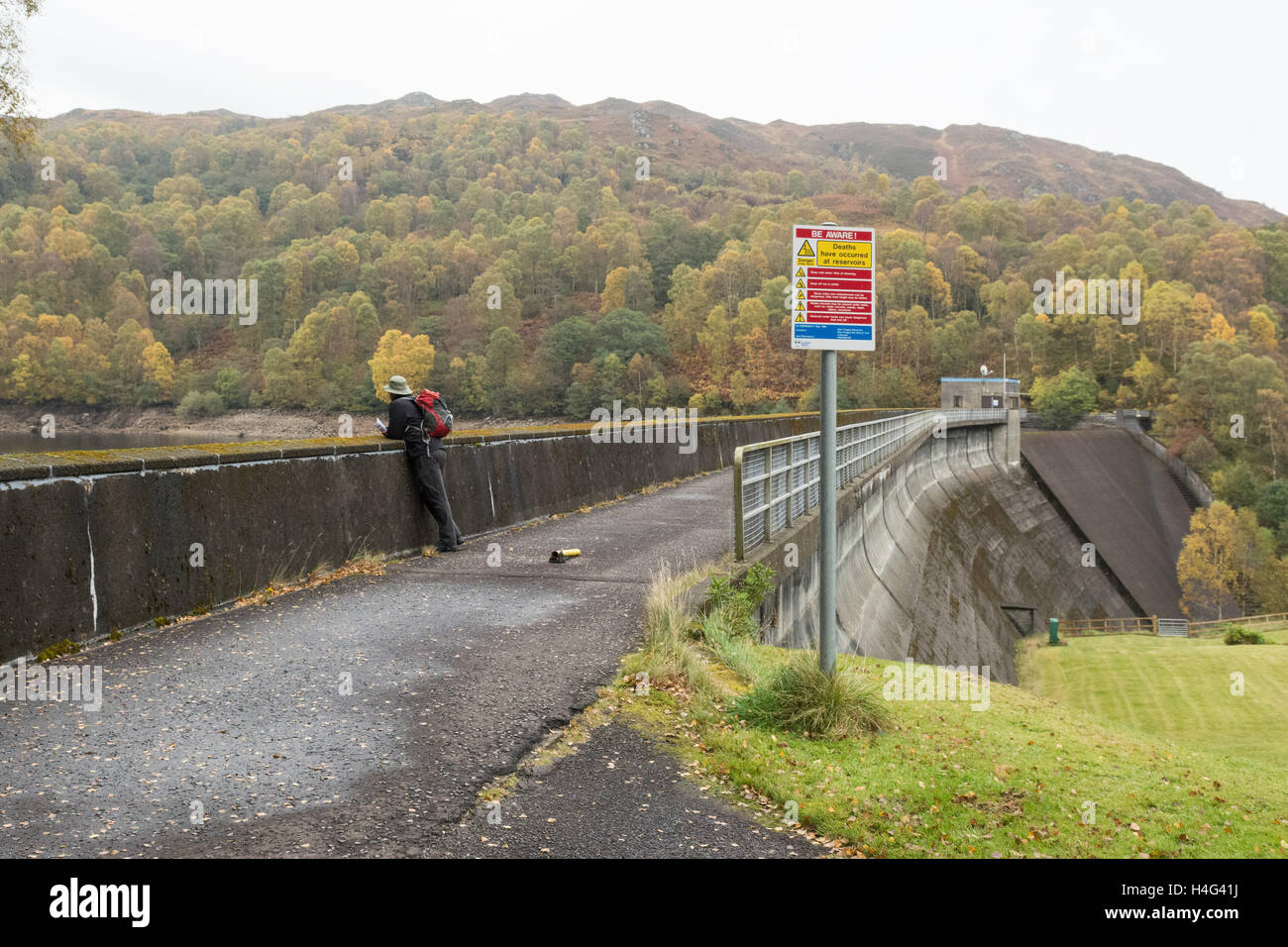 top of Glen Finglas Reservoir and 'deaths have occurred at reservoirs' warning sign, Glen Finglas, Trossachs, Scotland, Stock Photo