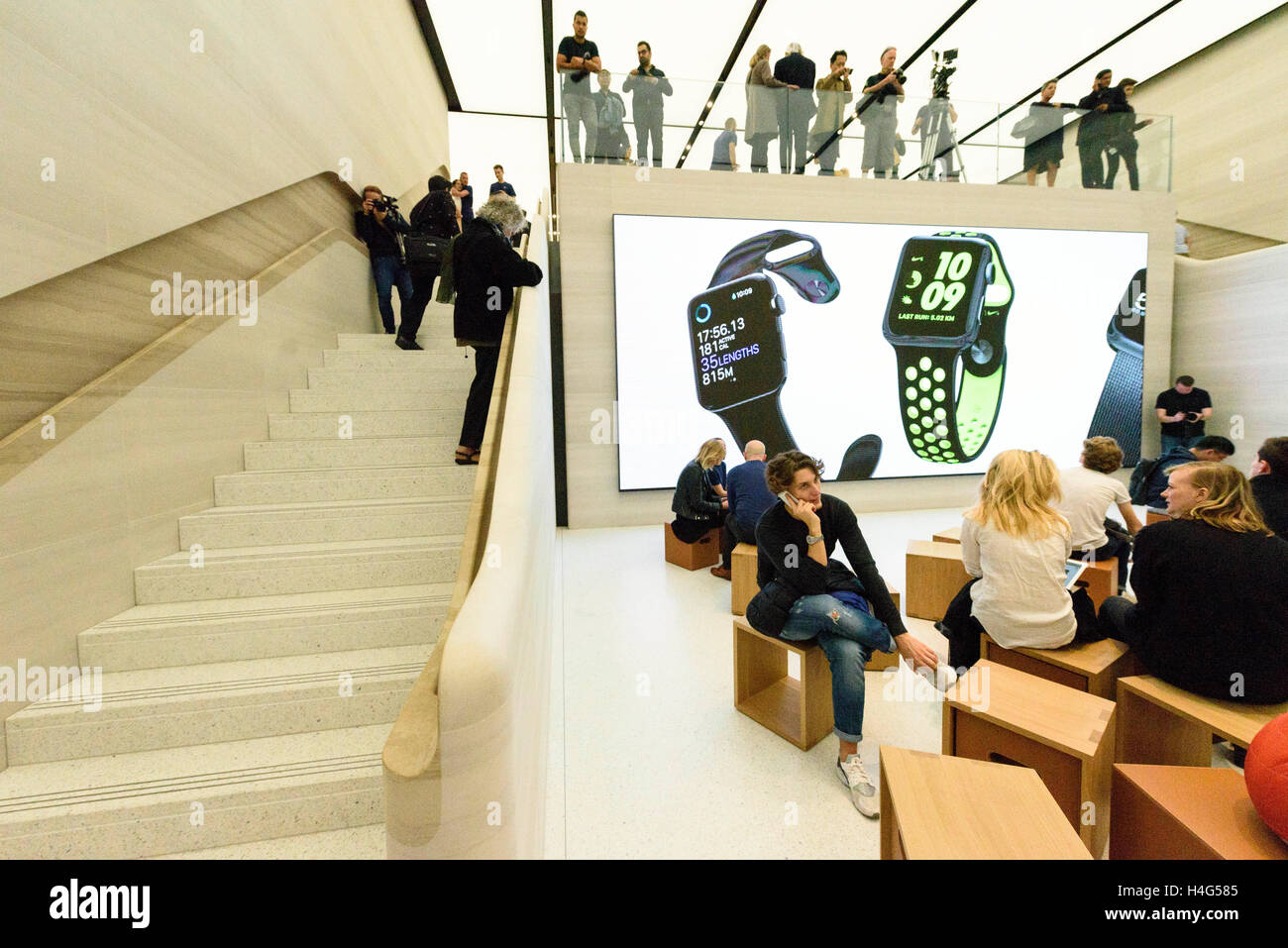 London, UK. 15th October, 2016. Customers shopping inside the Apple store in Regent Street with a new exterior and Stock Photo