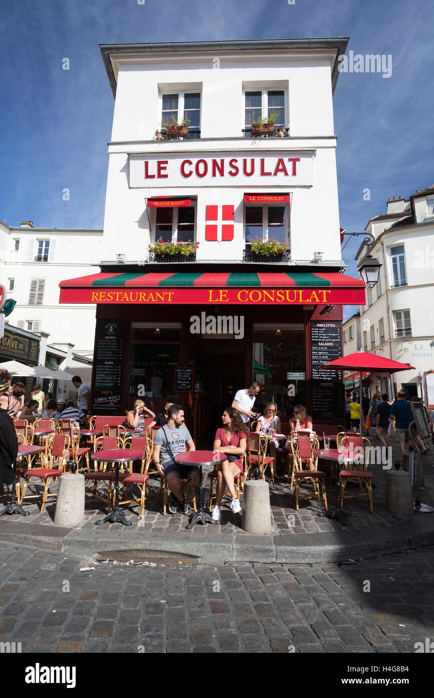 PARIS - AUGUST 14: View of typical paris cafe on August 14 2016 in Paris. Montmartre area is among most popular destinations in Paris Le Consulat is a typical cafe. Stock Photo