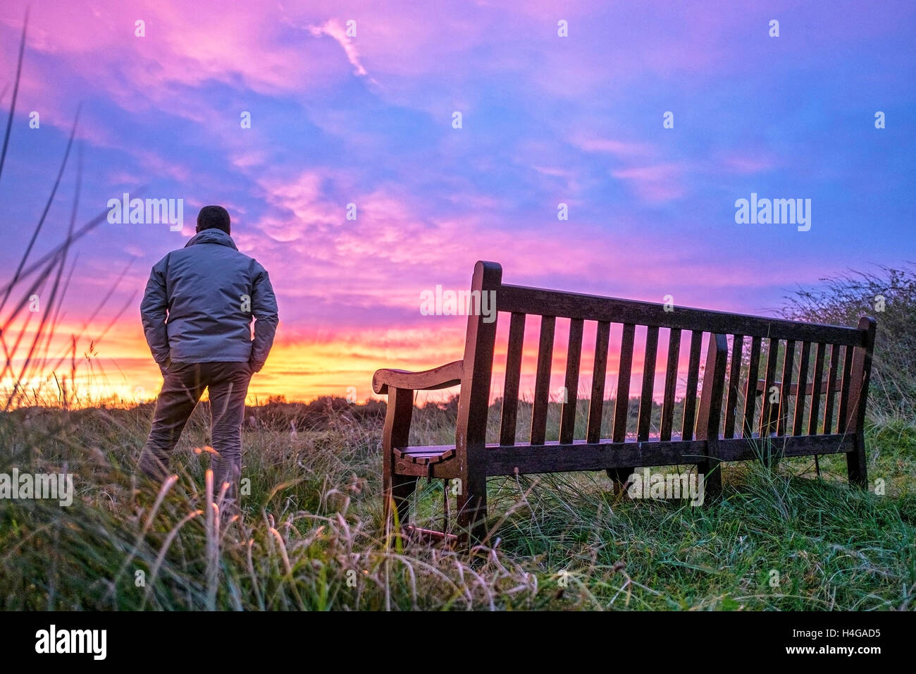 Southport, Merseyside, 16th October 2016.  After a cold and clear night, a beautiful sunrise breaks over the Marshside - Stock Image