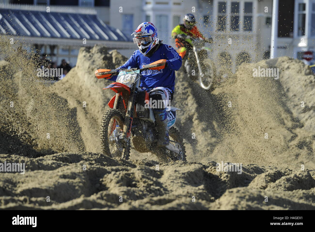 Weymouth, Dorset, UK.  16th October 2016. Competitors on their bikes testing themselves on the demanding circuit  of the Weymouth Lions Beach Motocross.  Photo by Graham Hunt/Alamy Live News Stock Photo