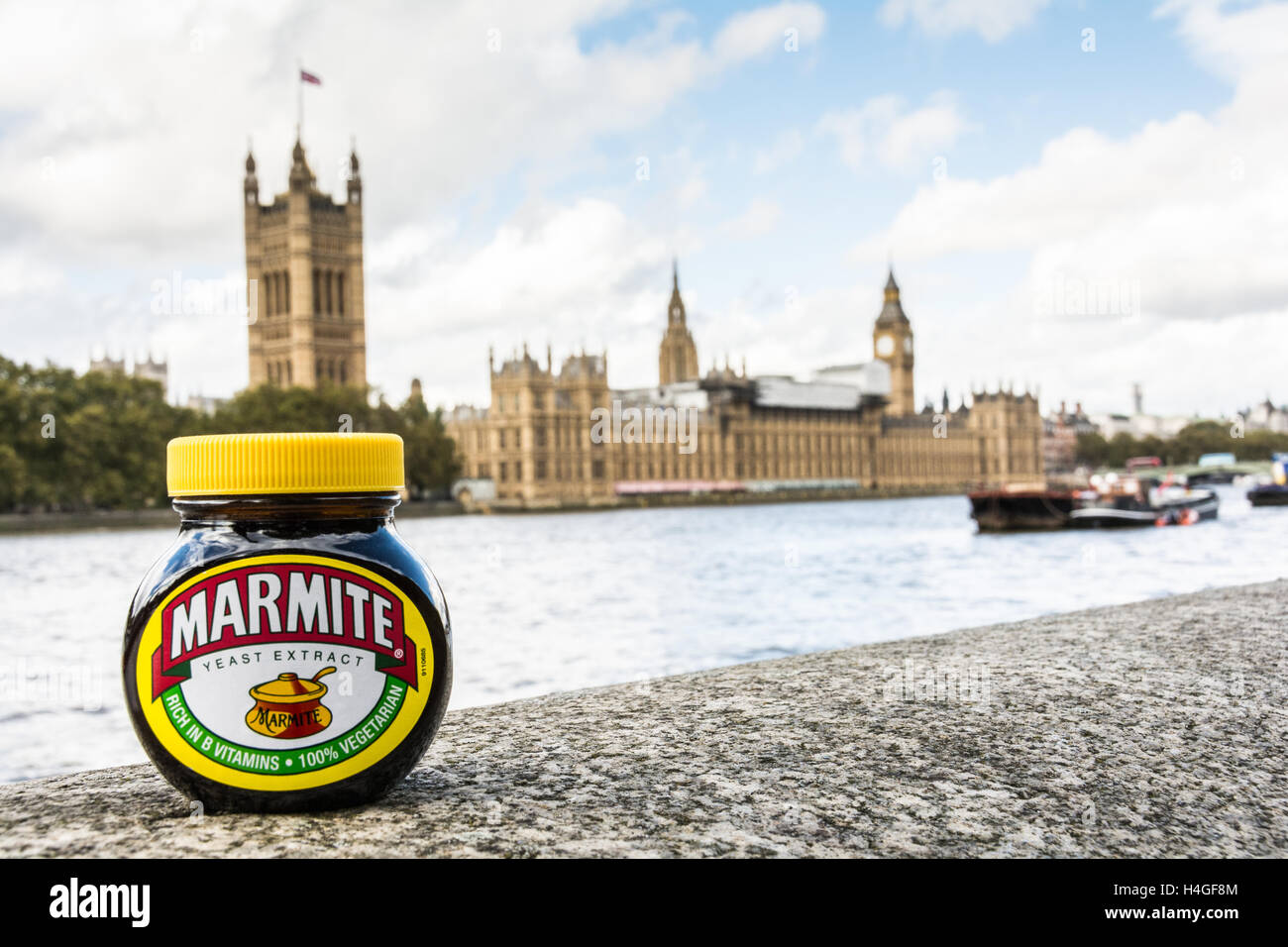 A marmite jar on the banks of the River Thames overlooking the Houses of Parliament - Stock Image