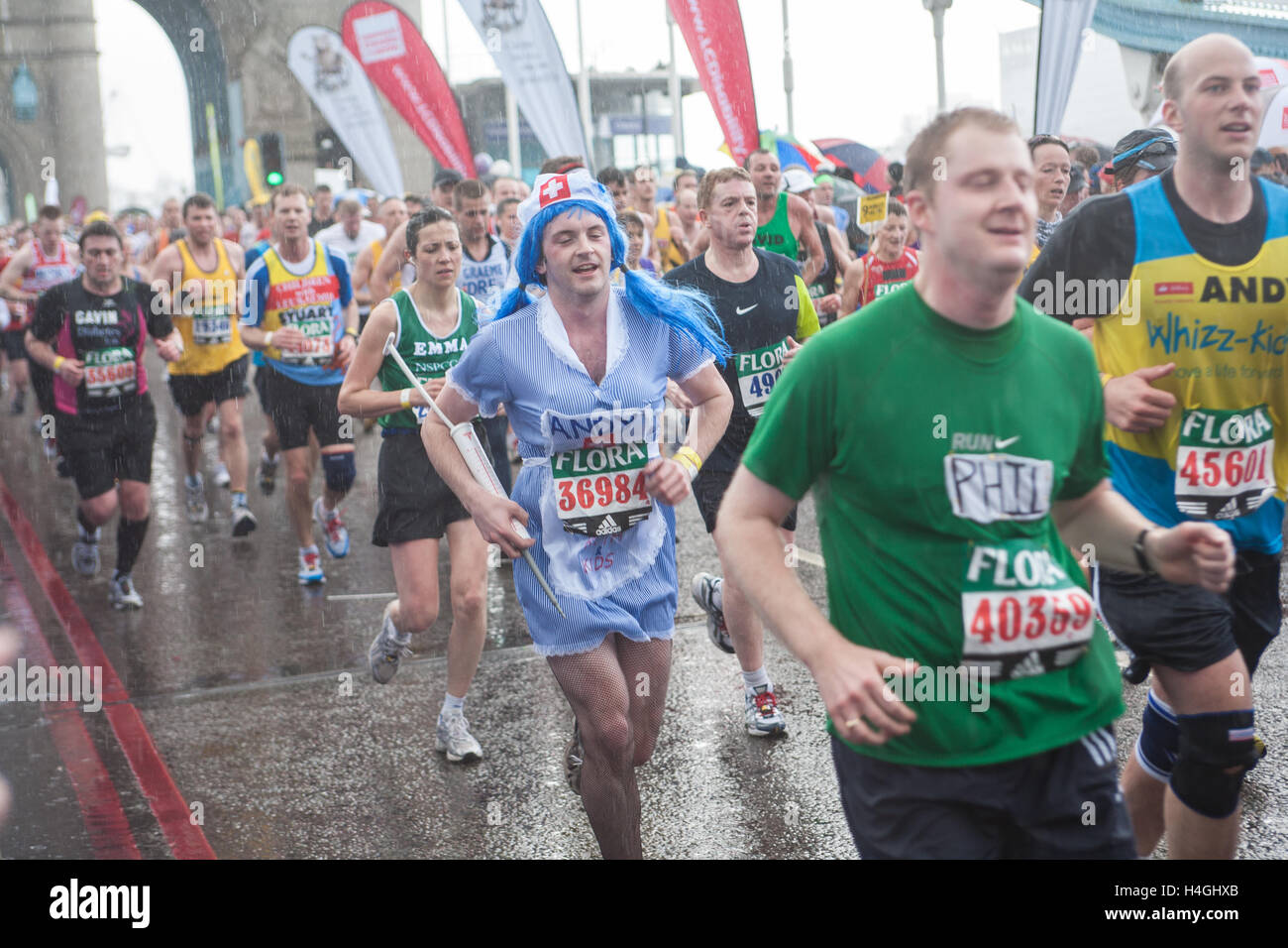 Runners participating running in iconic London Marathon,England. - Stock Image