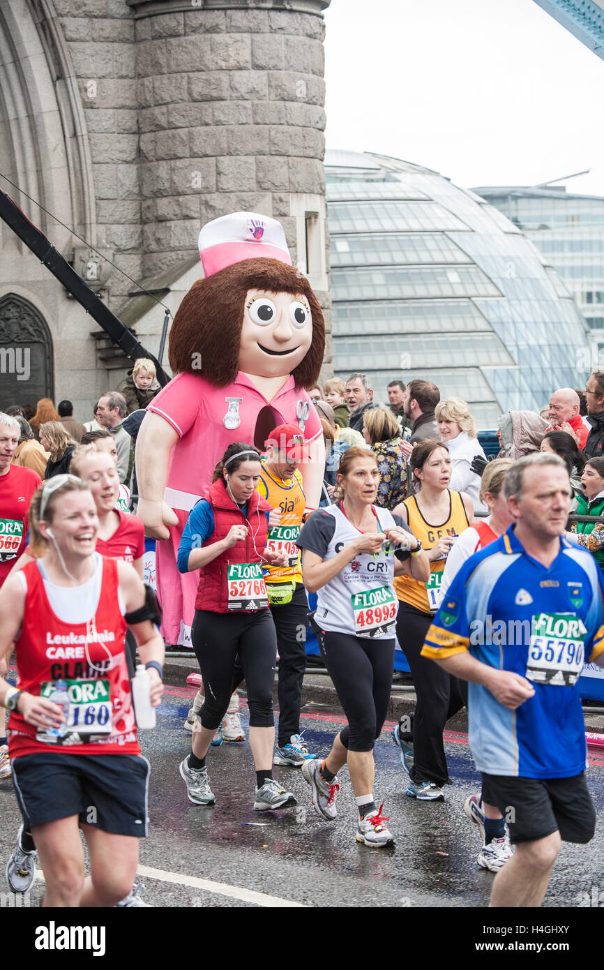 Runners participating running in iconic London Marathon,England. Well Child nurse. - Stock Image