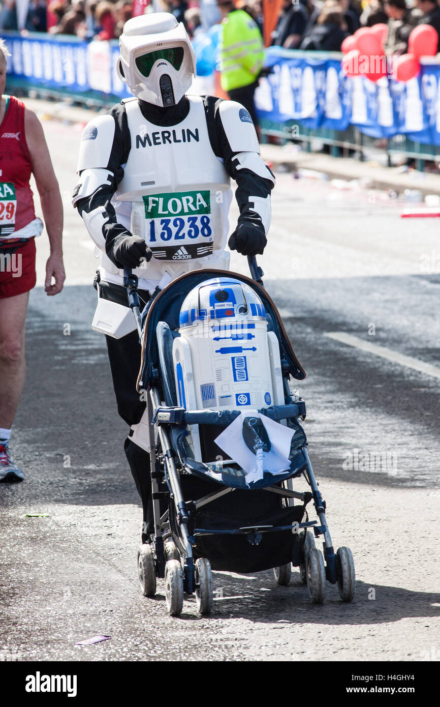 Star Wars,Stormtrooper,and CP30,IN,WHEELCHAIR,Runners, participating running, in iconic London Marathon,England. - Stock Image