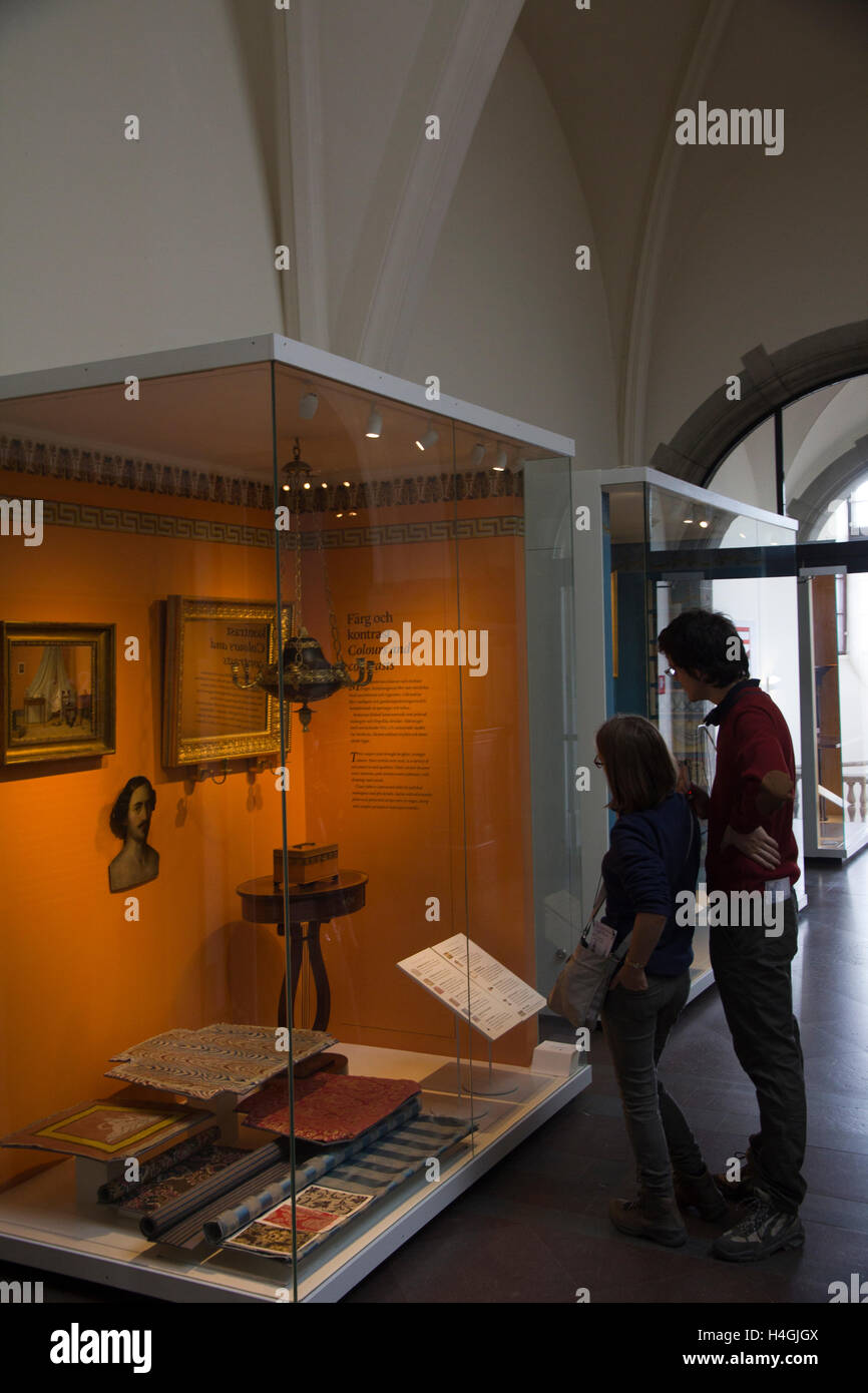 Visitors peruse the Home & Housing exhibit at the Nordic Museum in Stockholm, Sweden. - Stock Image