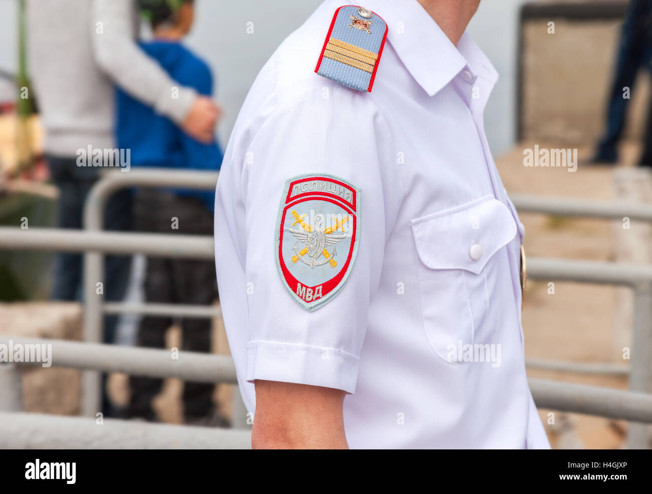 Chevron on the sleeve uniforms of the russian policeman. Russian police on transport - Stock Image