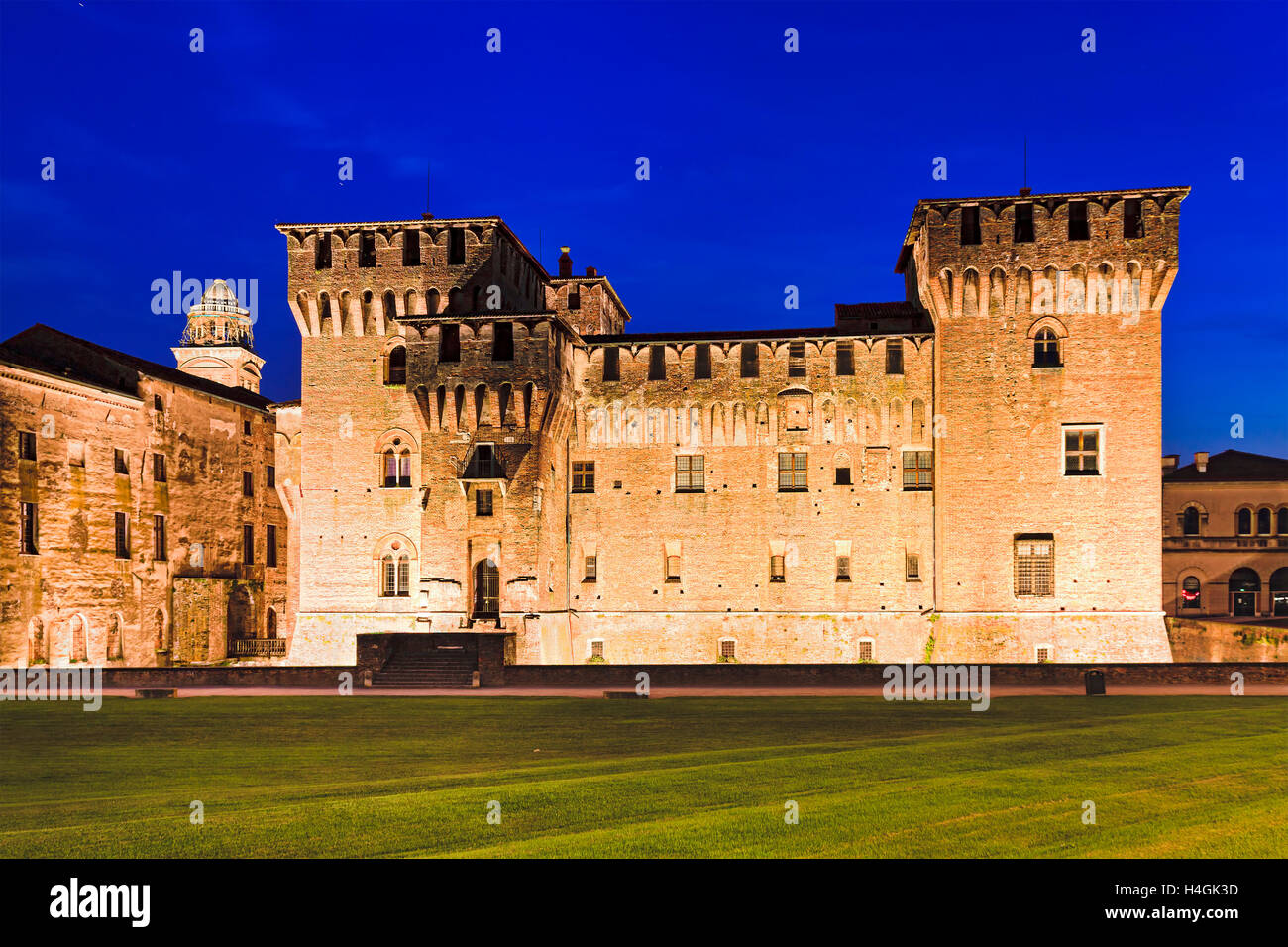 powerful towers of Ducale Palace Saint George castle at sunset in Mantua, Italy. Brightly illuminated medieval landmark - Stock Image