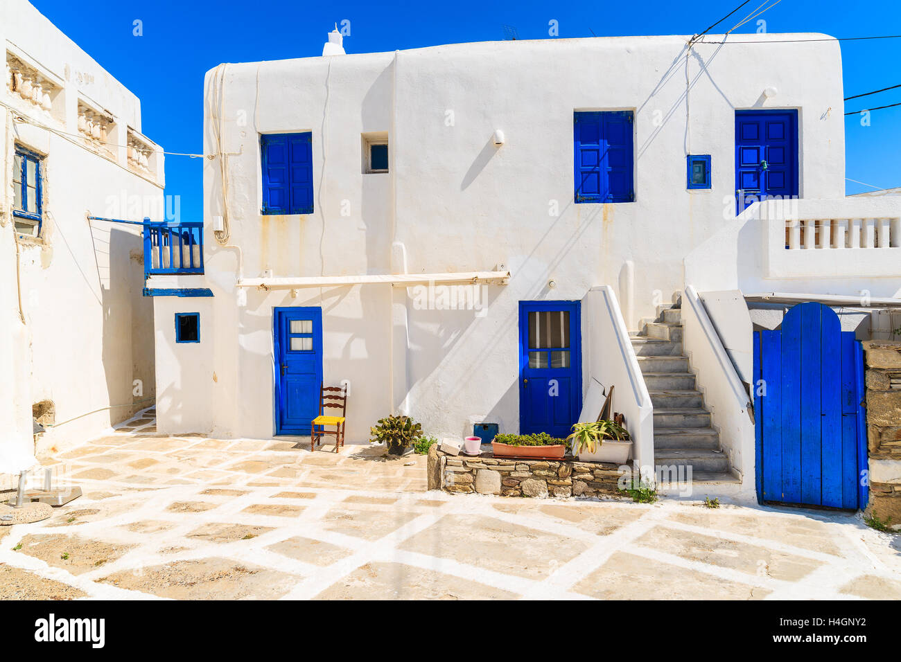 Typical Greek House Blue Windows And Doors On Whitewashed