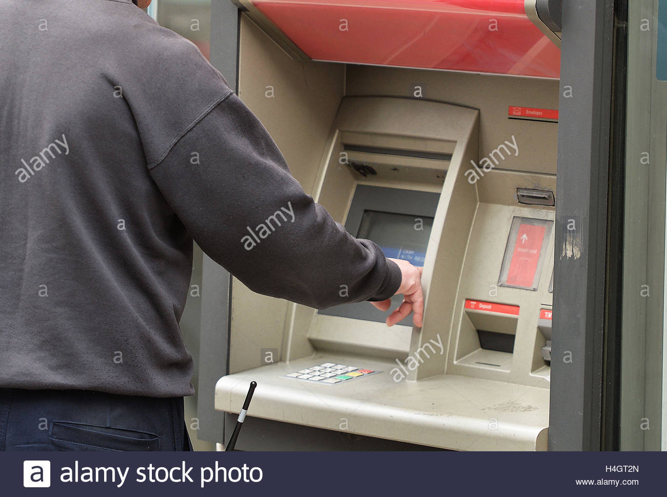 EMBARGOED TO 0001 MONDAY OCTOBER 17 File photo dated 27/04/16 of a man using a cash machine outside in central London, - Stock Image