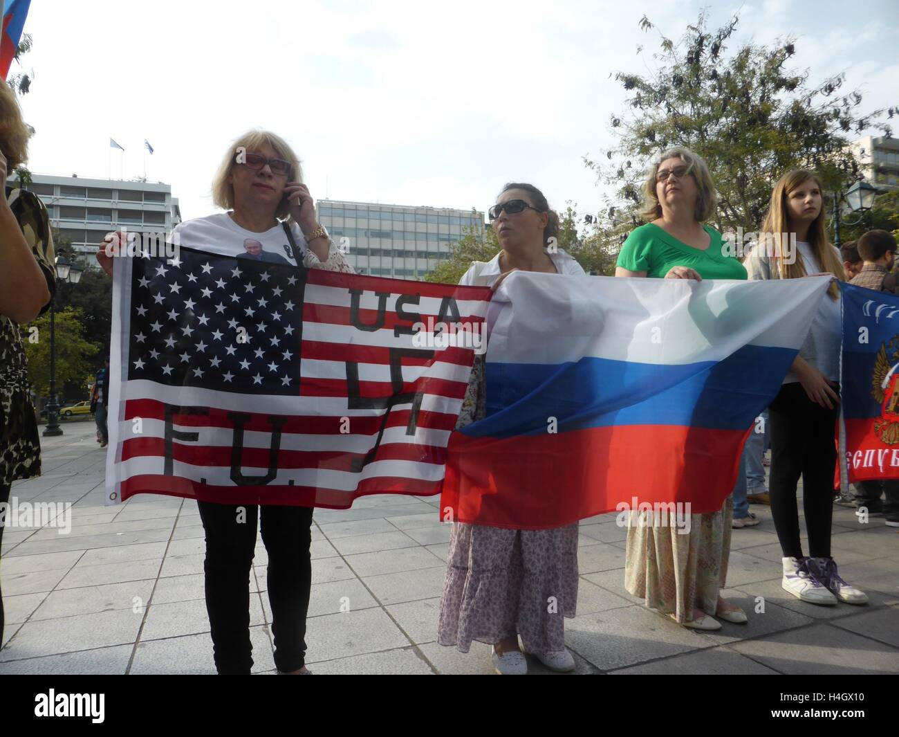 Athens, Greece. 16th Oct, 2016. A demonstrator holds an Americcan flag with a Swastica on it. Ukranian people demonstrate Stock Photo