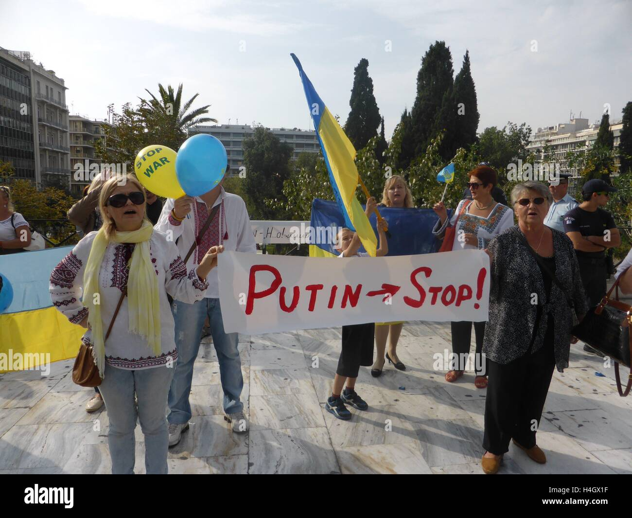 Athens, Greece. 16th Oct, 2016. Demonstrators hold a banner against Puttin. Ukranian people demonstrate in Athens - Stock Image