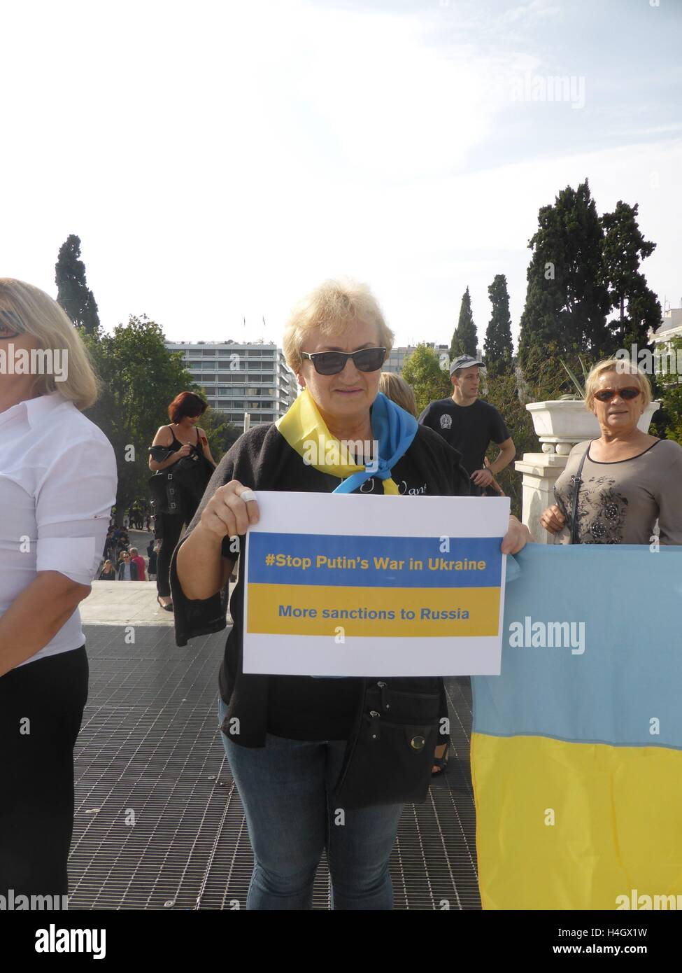 Athens, Greece. 16th Oct, 2016. A demonstratorr holds a picket with a message against Putn and war in Ukraine. Ukranian Stock Photo
