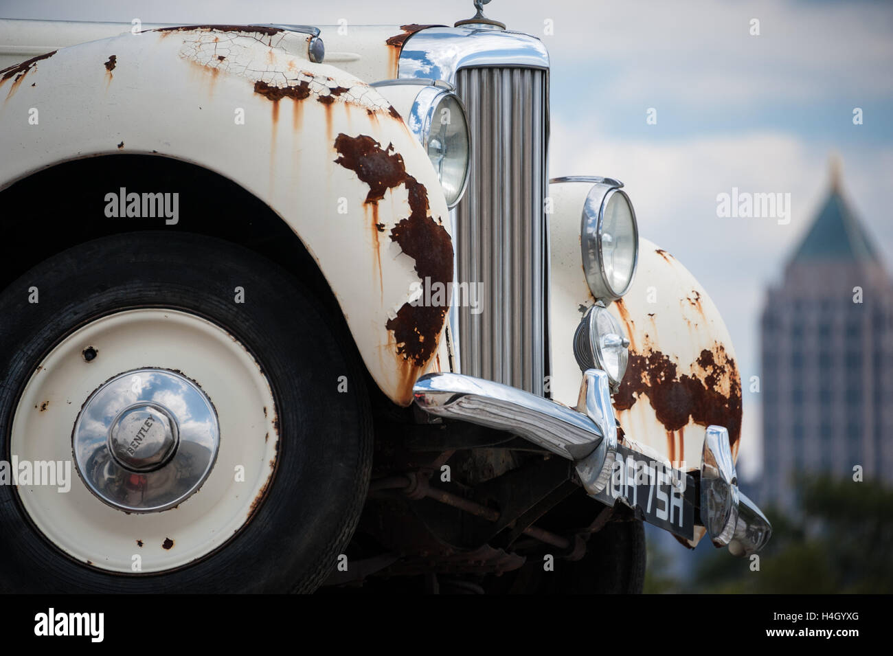 British classic white Bentley, a luxury icon of a former age, sits rusting near downtown Atlanta, Georgia. - Stock Image