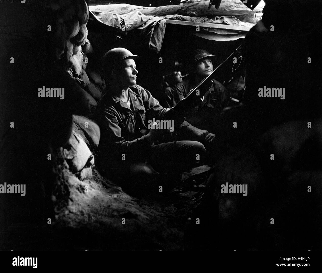 U.S. Army infantrymen with the 27th Infantry Regiment take cover in tunnels on the frontline during the battle of - Stock Image