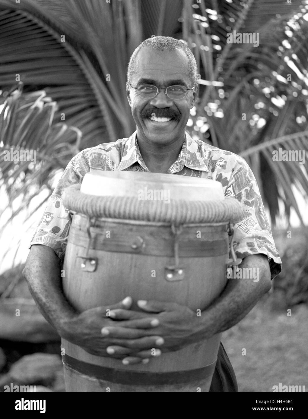 A Belle drummer hugs his drum in happiness. Fort de France, Martinique. Caribbean. - Stock Image