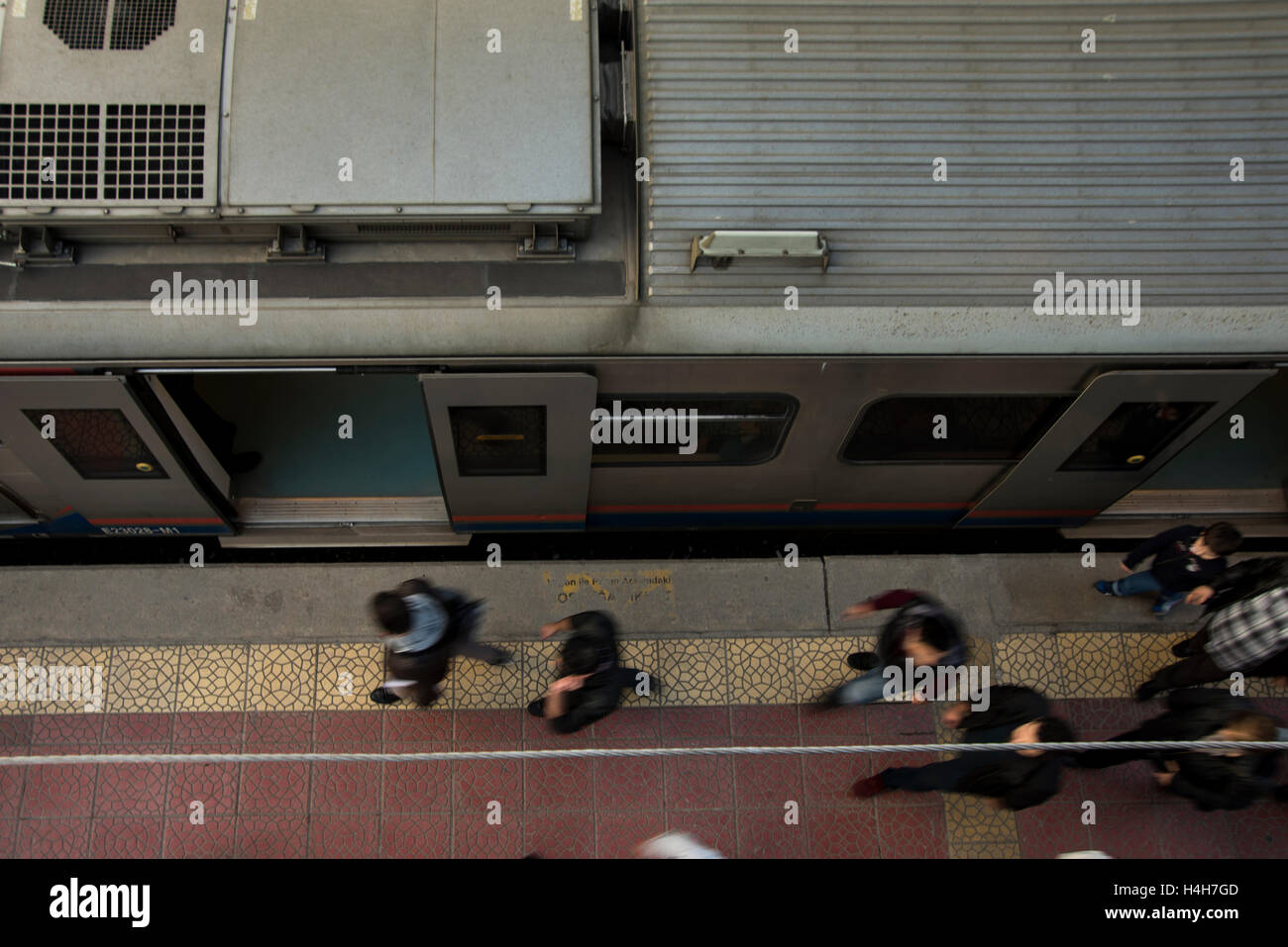 Top view of the train station. Crowded people is walking near the  train. December 25 2014 Izmir Turkey. Halkapinar - Stock Image