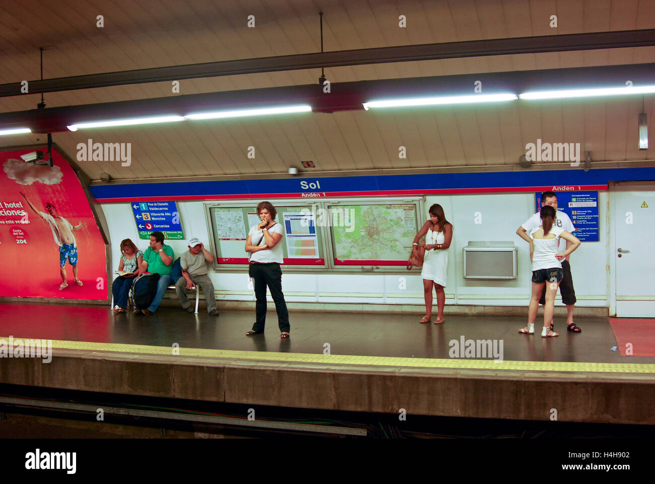 People wait for their train at a Subway station in Madrid,Spain - Stock Image