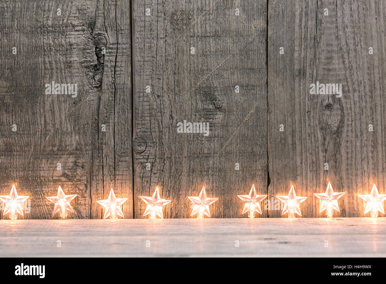 Christmas Lights On A Rustic Wooden Plank Background