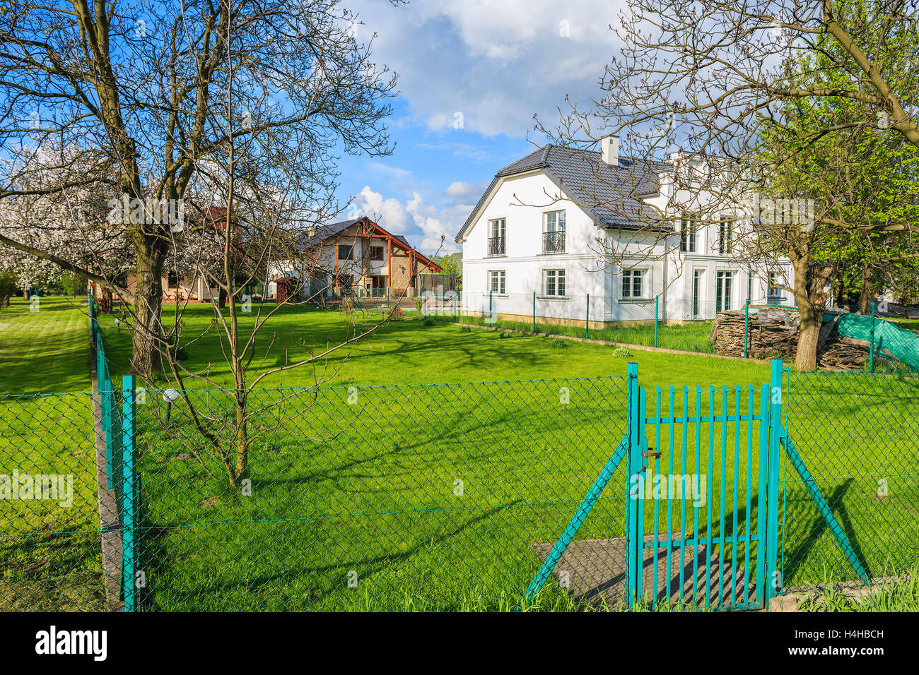 KRAKOW, POLAND - MAY 8, 2016: green garden of luxury house in Krakow ...