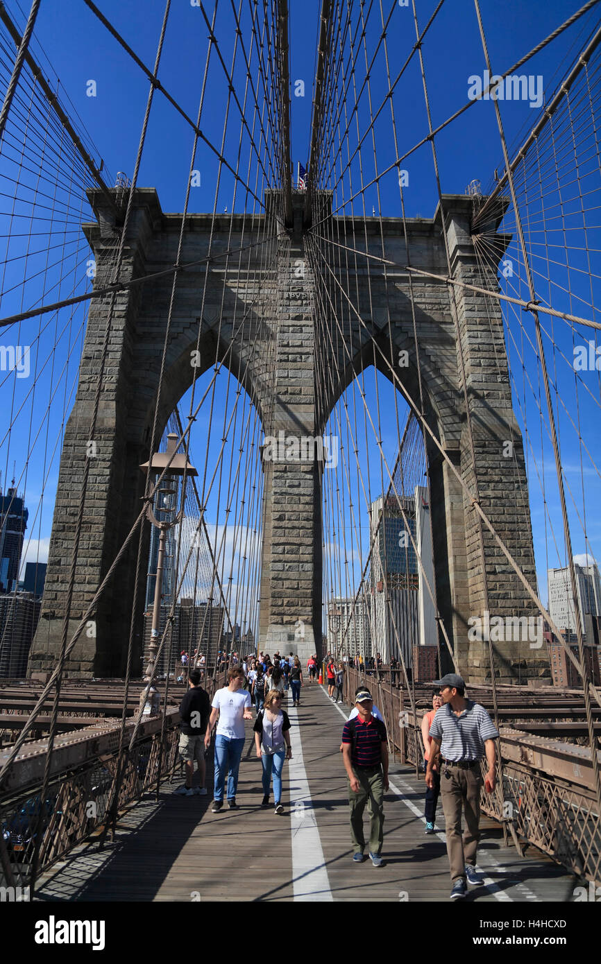 Tourists on  Brooklyn Bridge, New York, USA - Stock Image