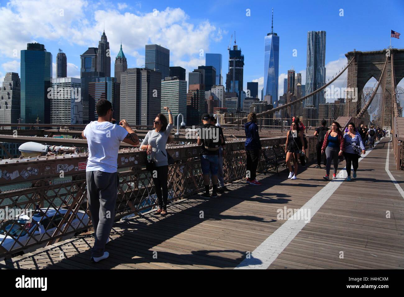 Tourists on  Brooklyn Bridge, New York, USA - Stock Image