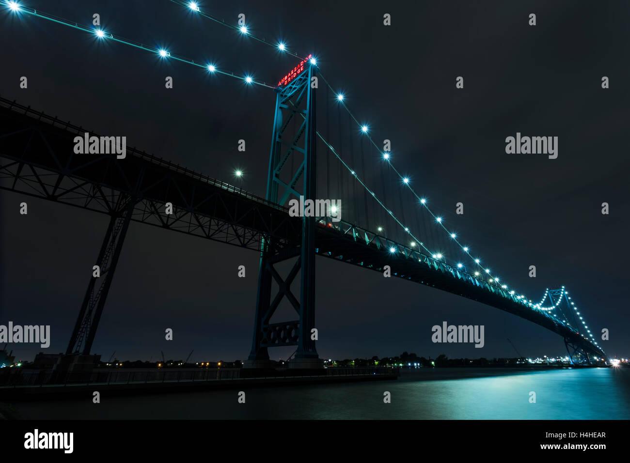 Ambassador Bridge connecting Windsor, Ontario to Detroit Michigan at night. - Stock Image