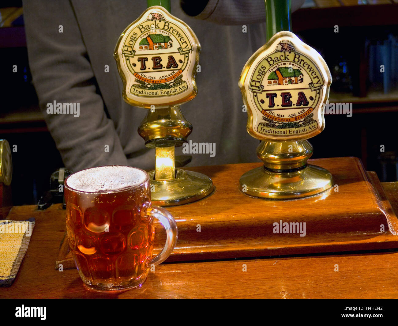 Pulling a pint of 'T.E.A.' Traditional English Ale at the Hogs Back Brewery in Tongham Surrey UK - Stock Image