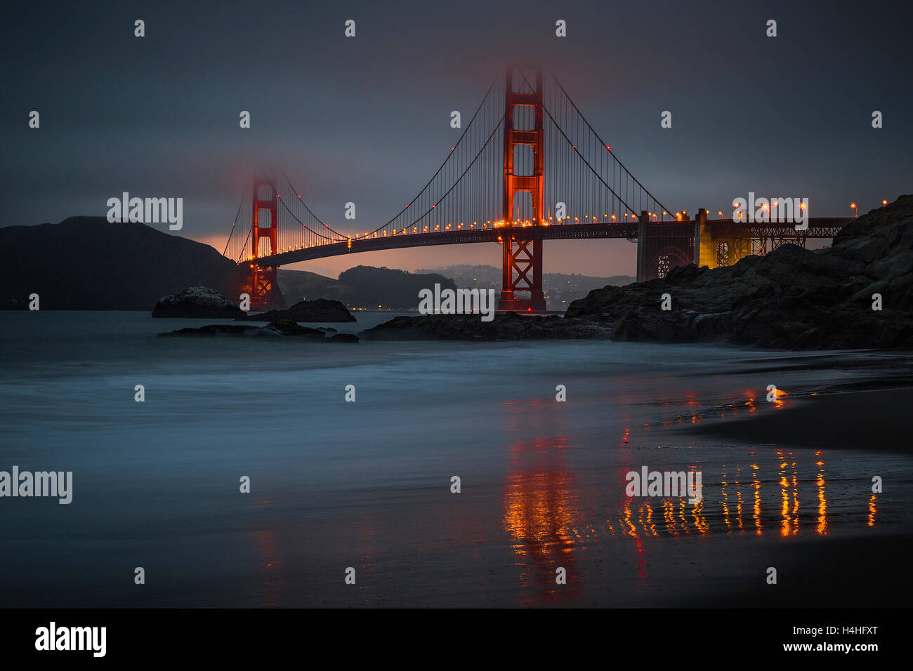 The Golden Gate Bridge at dusk, photographed from Baker Beach - Stock Image