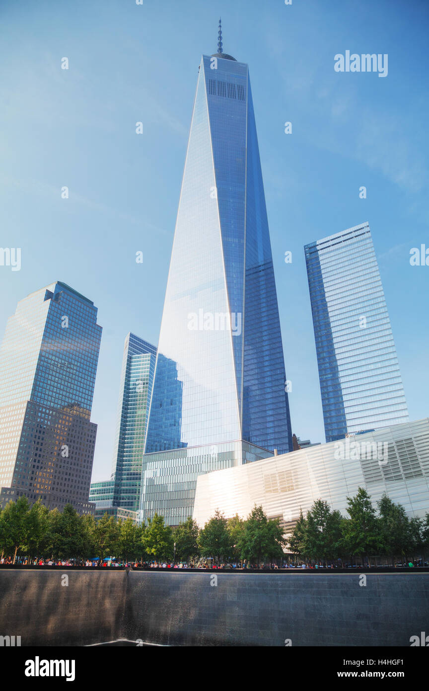 NEW YORK CITY - SEPTEMBER 3: One World Trade Center and 9/11 Memorial with people on September 3, 2015 in New York - Stock Image