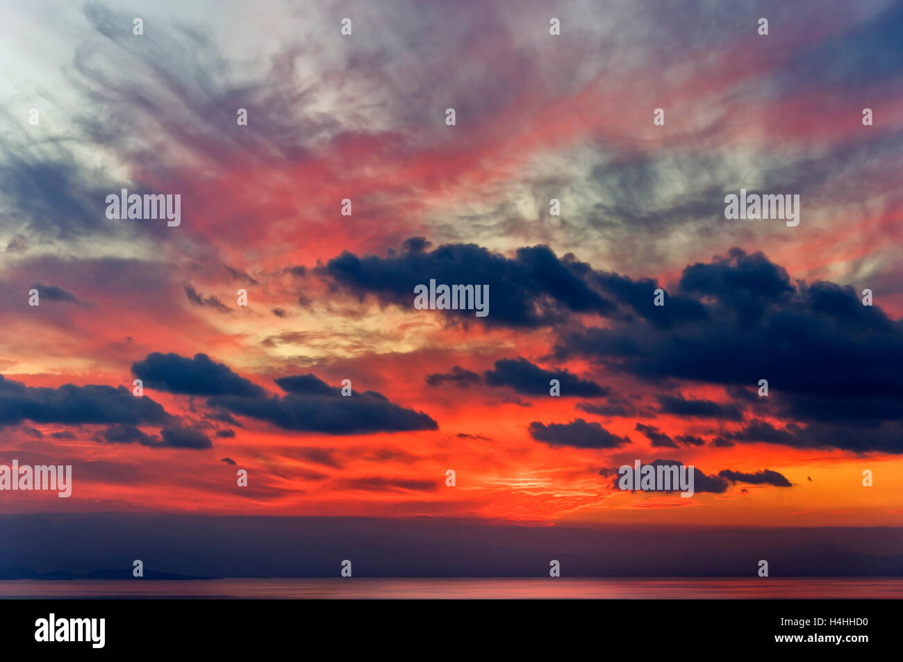 Red evening sky above the Pagasitc Gulf, Thessaly, Greece - Stock Image