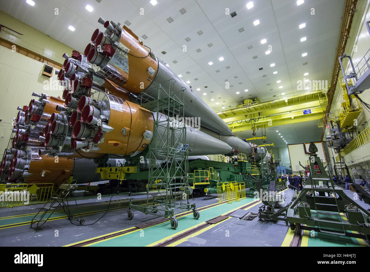 The Soyuz rocket and Soyuz MS-02 spacecraft are assembled at the Baikonur Cosmodrome in preparation for launch to - Stock Image