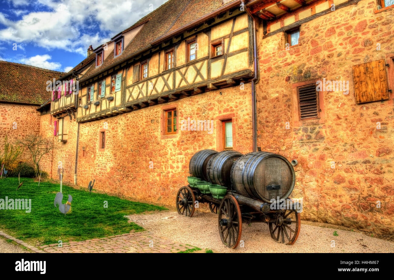 Cart with wine barrels in Riquewihr - Alsace, France Stock Photo