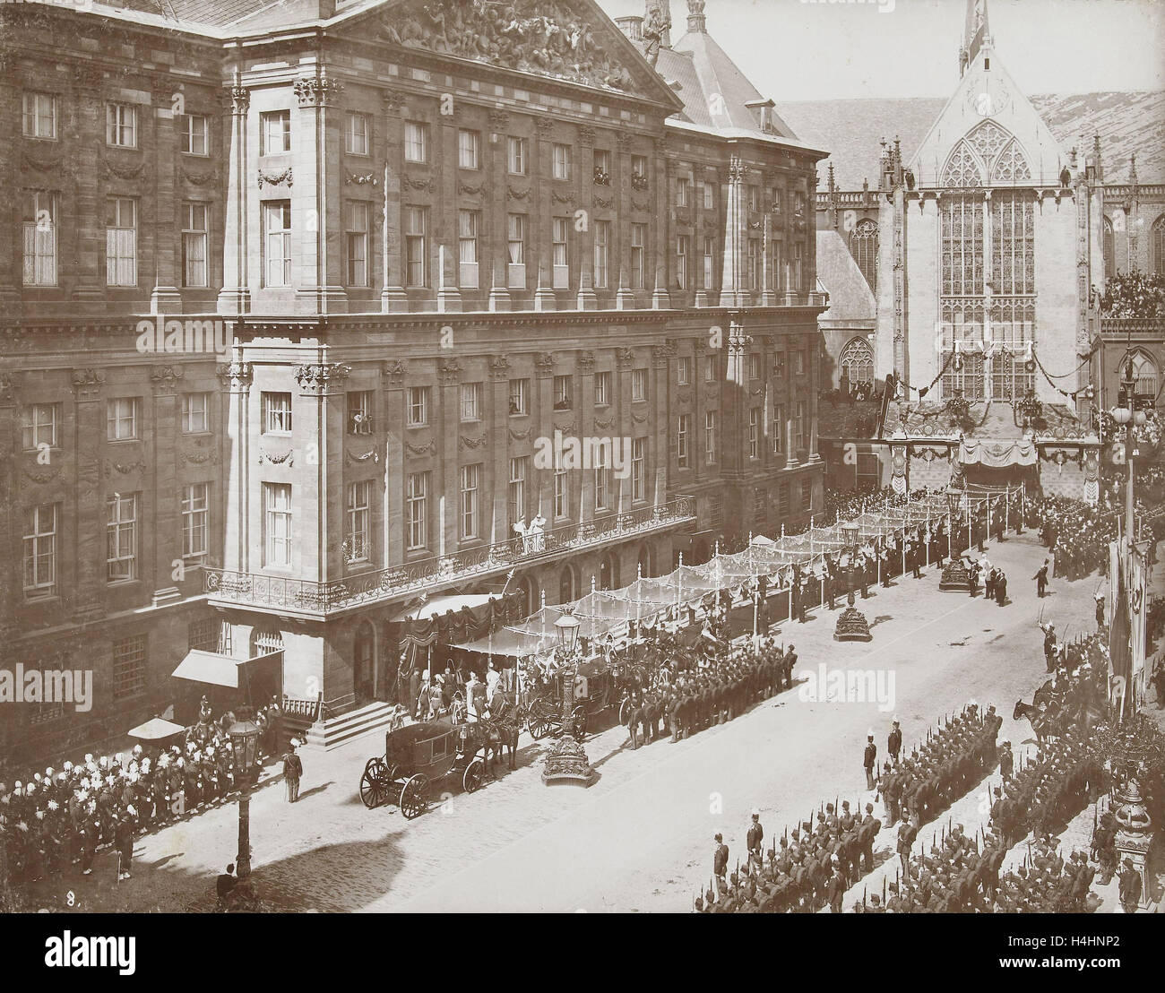 Salute Wilhelmina by soldiers and civilians after her coronation as Queen at the Royal Palace on Dam Square, Amsterdam - Stock Image