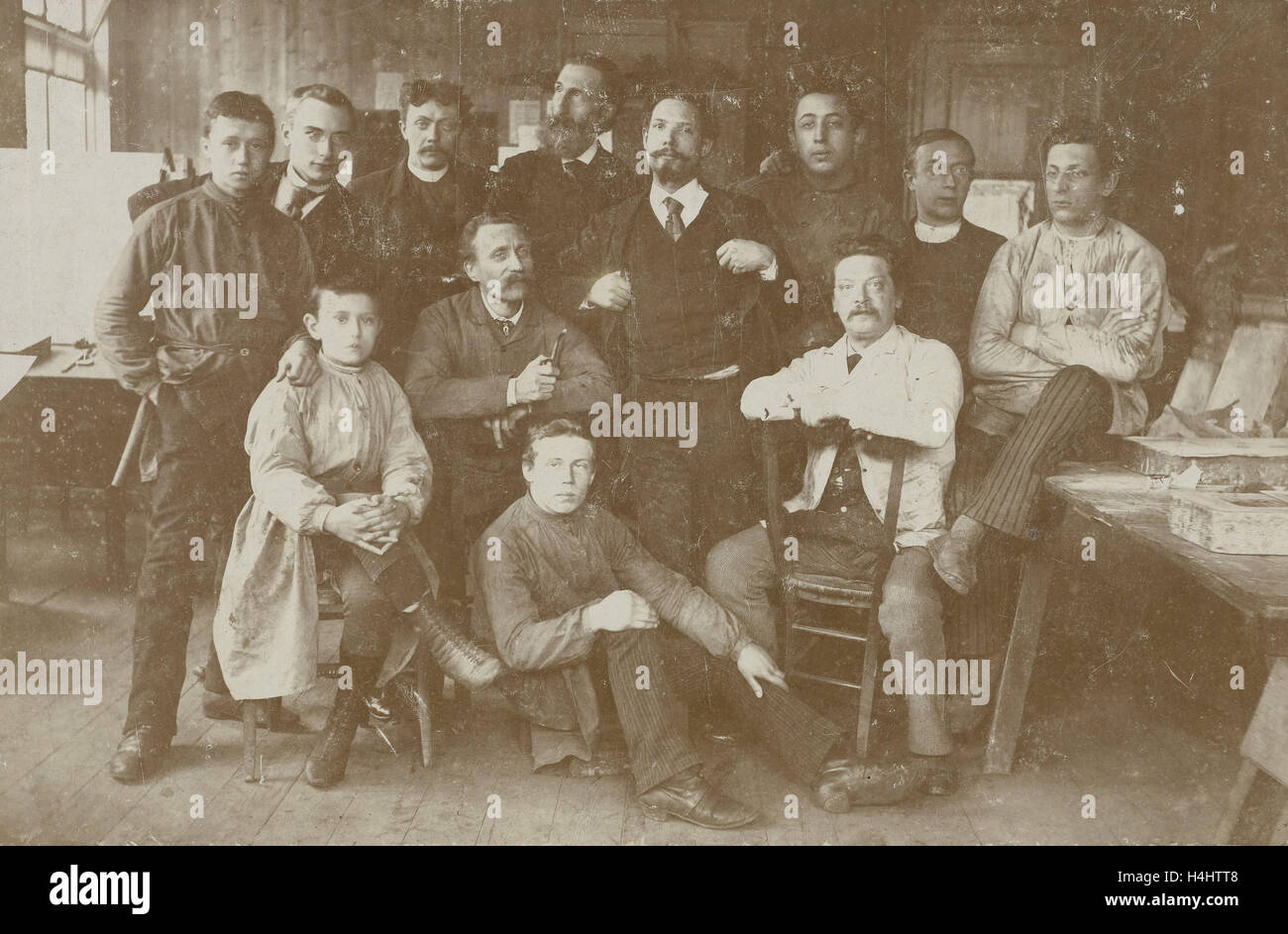 Group portrait employees lithographic printing, Anonymous, 1880 - 1910 - Stock Image