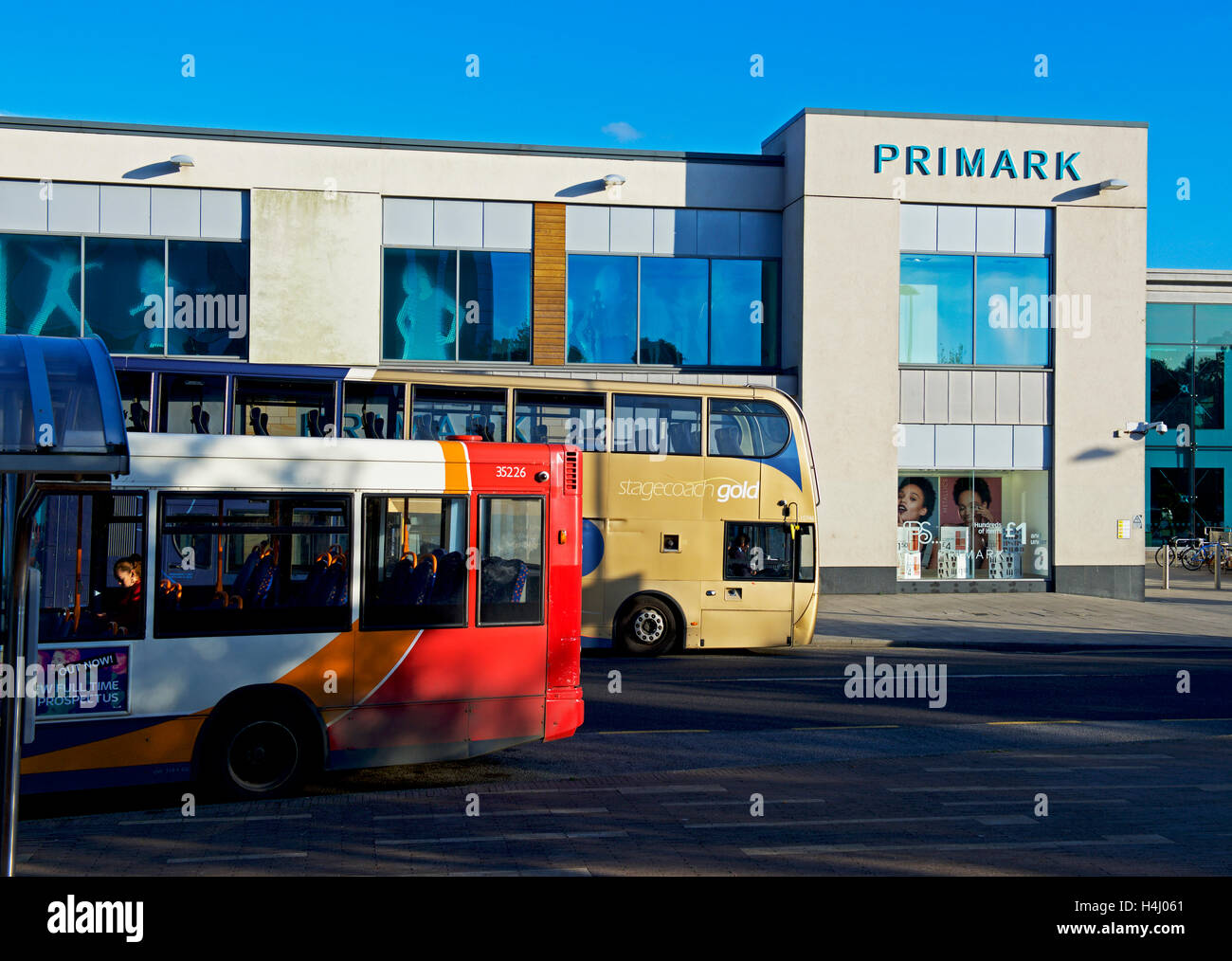 Buses outside Primark and the Willow Place Shopping Centre,Corby, Northamptonshire, England UK - Stock Image